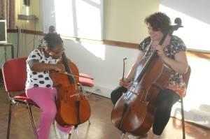 Student learning cello